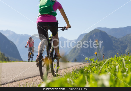 Active sporty woman riding mountain bike in nature. stock photo, Active sporty woman riding mountain bike in the nature, Slovenia. by kasto
