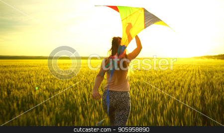 girl running around with a kite on the field. Freedom concept stock photo, girl running around with a kite on the field. Freedom concept. by petr zaika
