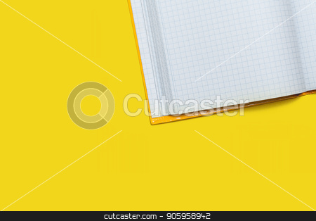 opened workbook on a yellow background stock photo, white opened workbook lying on a yellow background. concept of business or educational equipment. free space for advertising text by Oleh