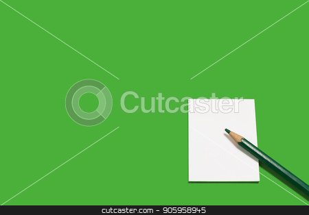 paper note and a green pencil stock photo, white sheet of paper note and a little black pencil lying on it on a green background. concept of business or educational equipment. free space for advertising text by Oleh