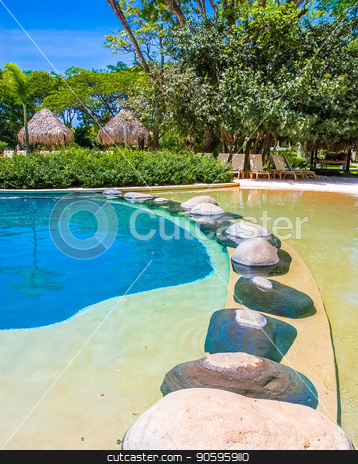 Stones Across Tropical Pool stock photo, Large stones in a tropical pool of blue water by Darryl Brooks