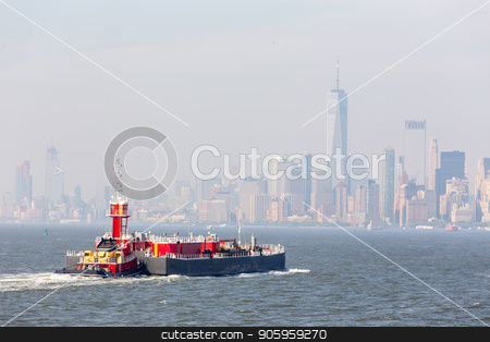 Freight tug pushing cargo ship to the port in New York City and Lower Manhattan skyscarpers skyline in background. stock photo, Freight tug pushing cargo ship to the port in New York City and Lower Manhattan skyscarpers skyline in background. New York City, USA. by kasto