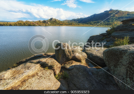 Beauty view on Kolyvan lake stock photo, Beauty view on Kolyvan lake - a lake at the foot of the northern slope of the Kolyvan Ridge in the Altai Territory of Russia by olinchuk