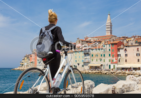 Young active female tourist cycling and enjoiying beautiful view of Rovinj, Istria, Croatia. stock photo, Young active female tourist cycling and enjoiying beautiful view of Rovinj, Istria, Croatia. by kasto