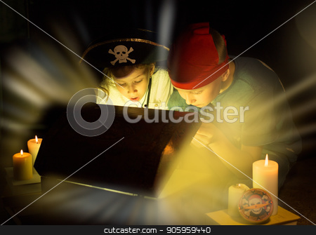 Cute girl and adventurous boy found a treasures. Happy young pirates. stock photo, Childhood dreams. Cute girl and adventurous boy found a treasures. Happy young pirates. by Alfira Poyarkova