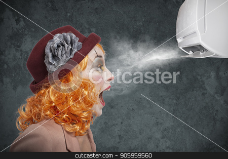 Clown amazed by the fresh of air conditioner stock photo, Clown girl amazed by the fresh of air conditioner by Federico Caputo
