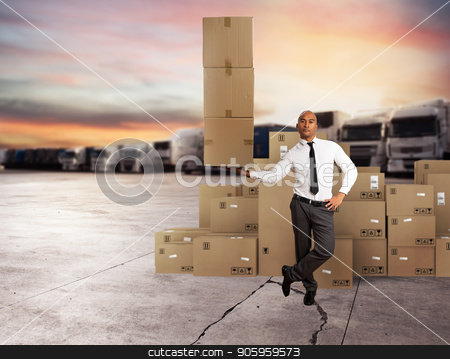 Businessman holds a pile of packages in a hand. concept of fast delivery stock photo, Businessman holds a pile of packages in a hand. concept of fast and easy delivery by Federico Caputo