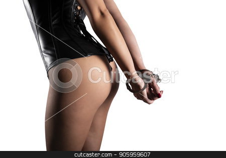 Sensual provocation of a sexy girl handcuffed stock photo, Sensual provocation of a sexy bdsm handcuffed woman in lingerie by Federico Caputo
