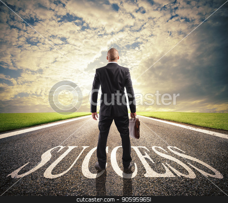 Man walks on a success way. Concept of successful businessman and company startup stock photo, Man walks on a big success way. Concept of successful businessman and company startup by Federico Caputo