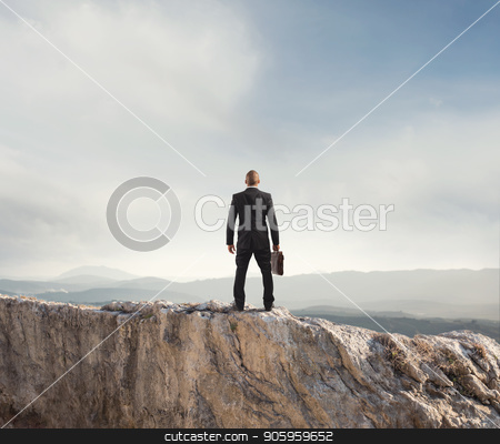 Businessman looks far to the future of the business stock photo, Businessman looks far to the future of the business on mountain by Federico Caputo