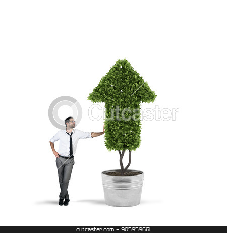 Businessman that cultivates a plant with a shape of arrow. Concept of growing of company economy . stock photo, Businessman cultivates a plant that grows like an arrow . Concept of growing of company economy . by Federico Caputo