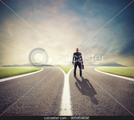 Businessman in front of a crossway must select the right way stock photo, Businessman in front of a crossway must select the right way of success by Federico Caputo