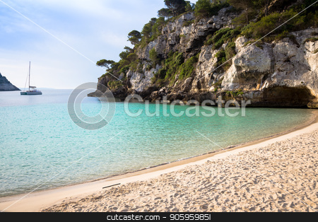 Cala en Turqueta (Turqueta Beach) in Menorca, Spain stock photo, MENORCA, SPAIN - June 29, 2018: The most beautiful beach in Menorca during first hours of the day (07:00), summer season by Paolo Gallo