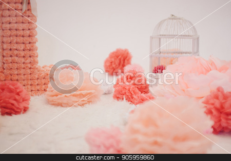 bird cage and artificial pink flowers on white floor stock photo, bird cage and artificial pink flowers on white floor by aaalll3110
