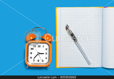 copybook, alarm clock and a pen stock photo, white opened copybook, orange alarm clock and a black pen lying on the blue background. concept of office and educational chancery by Oleh