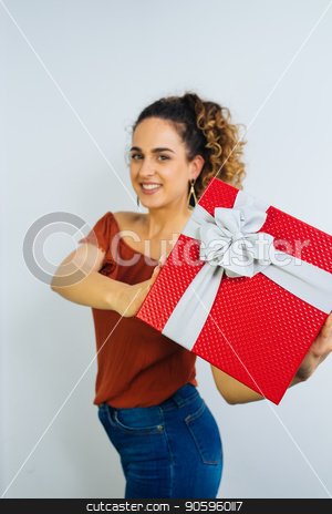 Happy Valentines Day stock photo, Attractive Curly Long Haired Woman Is Holding A Gift Box With Ribbon Isolated On White Background by Vera Arsic