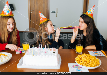 Children at birthday party stock photo, Group of kids celebrate birthday together and blowing in the whistles by Vera Arsic