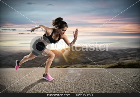 Athletic woman runs on the street during sunset stock photo, Athletic woman runs fast on the street during sunset by Federico Caputo