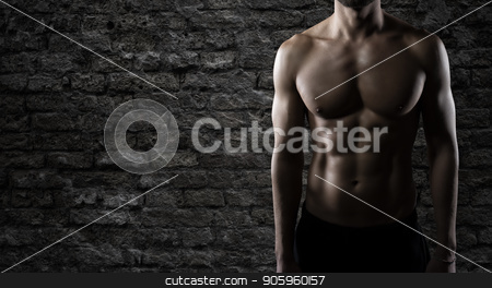 Muscular of a body building trainer man stock photo, Body building trainer shows his power muscles by Federico Caputo