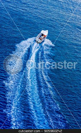 Boat Speeding Away stock photo, A white motorboat speeding away across a blue bay by Darryl Brooks