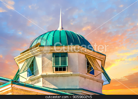 Green Dome on Blue stock photo, an old cupola with a green roof against a blue sky by Darryl Brooks