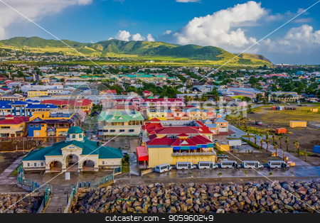 Colorful Town and Green Hills stock photo, A colorful town on the coast of St Kitts with green hills behind by Darryl Brooks