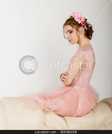 cute young woman in delicate pink dress sits on sofa, professional hairstyle with wreath. stock photo, cute young woman in delicate pink dress sits on sofa, professional hairstyle with wreath by Alexander