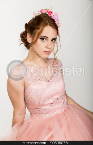 portrait of cute young woman in delicate pink dress, professional hairstyle with wreath stock photo, portrait of cute young woman in delicate pink dress, professional hairstyle with wreath. by Alexander
