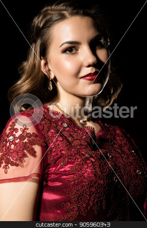 pensive beautiful woman in red dress on a dark background. professional hairstyle and make-up stock photo, pensive beautiful woman in red dress on a white background by Alexander