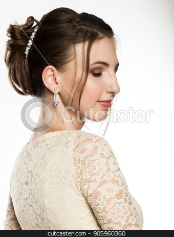 portrait of tender young woman in cream dress on a white background. professional make-up stock photo, portrait of tender young woman in cream dress on a white background. professional make-up. by Alexander