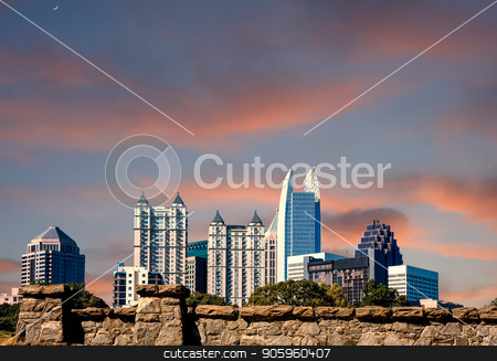 City Skyline Past Stone Wall stock photo, The skyline of Atlanta shot over an old granite stone wall on a sunny day by Darryl Brooks