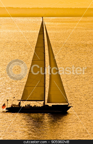 Sailboat in Golden Bay stock photo, A sailboat in the bay at sunset by Darryl Brooks