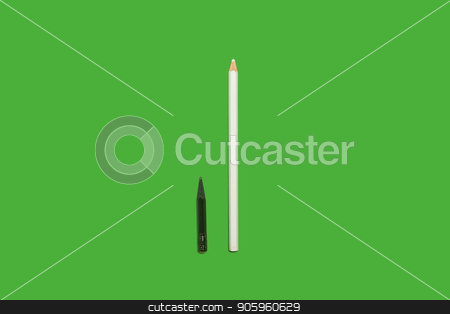 Black used and white new pencils stock photo, Black small used and white long new pencils lying on a green background. concept of office and educational chancery by Oleh