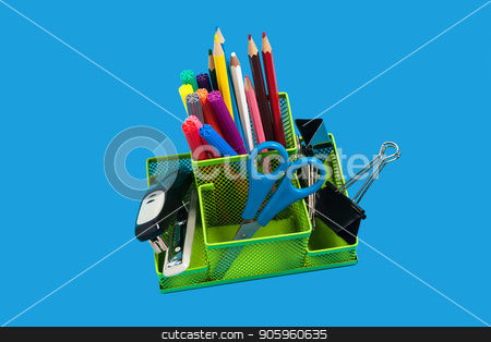 green empty pencil holder on an orange surface stock photo, green pencil holder full of felt pens, pencils, scissors and educational supplies standing on the blue background. concept of office or school supplies by Oleh