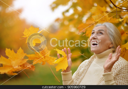 Happy beautifil elderly woman posing  stock photo, Happy beautifil elderly woman posing  in park by Ruslan Huzau