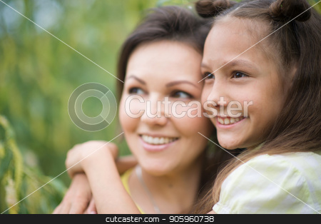 cute girl with her mother stock photo, Little cute girl with her mother in summer park by Ruslan Huzau