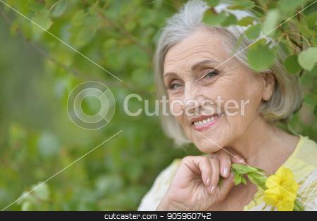 beautiful senior woman stock photo, Portrait of a beautiful senior woman in green park by Ruslan Huzau