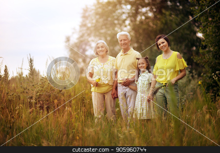happy family resting stock photo, Portrait of happy family resting in summer park by Ruslan Huzau