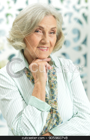 portrait of beautiful senior woman stock photo, Close up  portrait of beautiful senior woman posing by Ruslan Huzau