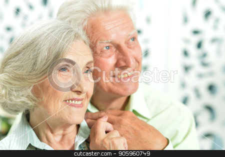 portrait of happy senior couple stock photo, close up portrait of happy senior couple at home by Ruslan Huzau