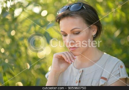 Portrait of sad young woman stock photo, Portrait of beautiful sad young woman outdoors by Ruslan Huzau
