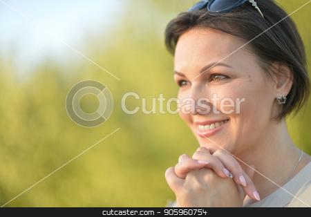 Beautiful young woman resting stock photo, Beautiful young woman resting in summer park by Ruslan Huzau