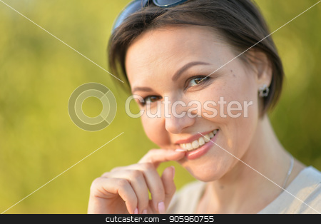Beautiful young woman resting stock photo, Beautiful young woman resting in summer park by Ruslan Huzau