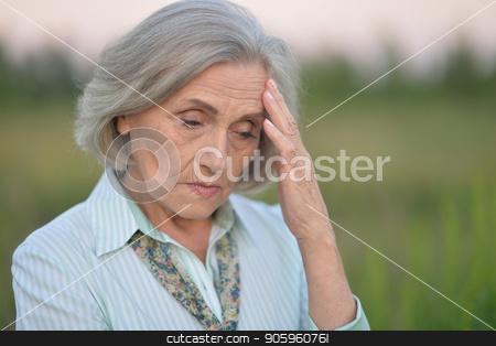 Portrait of sad senior woman  stock photo, Portrait of sad senior woman  in summer park by Ruslan Huzau