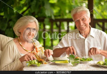 Senior couple having diner stock photo, Happy Senior couple having diner at home by Ruslan Huzau