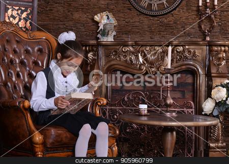 mother and son using laptop stock photo, mother and son lying on floor and using tablet by Ruslan Huzau