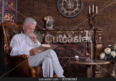 mature man reading book stock photo, mature man reading book at room with vintage interior by Ruslan Huzau