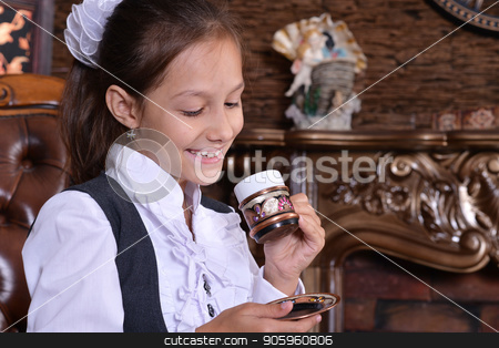 Girl drinking tea stock photo, Portrait of schoolgirl drinking tea in room with vintage interior by Ruslan Huzau