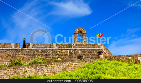 Fortress and Cannon Against Sky stock photo, Part of an old fortress in the tropics by Darryl Brooks