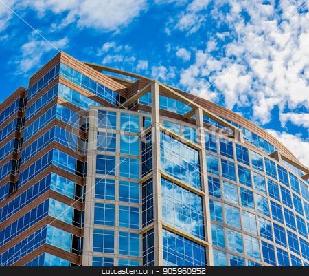 Clouds and Bright Sky Reflected stock photo, A modern office building reflecting sky and clouds by Darryl Brooks
